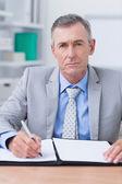 Unhappy businessman looking at camera — Stock Photo