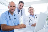 Team of doctor looking at camera — Stock Photo