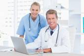 Smiling doctor and nurse — Stock Photo