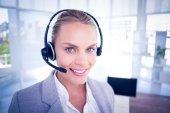 Businesswoman taking calls — Stock Photo