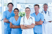 Doctors standing arms crossed — Stock Photo