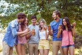 Happy friends in the park having picnic — Stock Photo