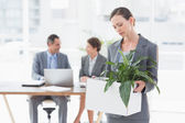 Businesswoman leaving office after being fired — Stock Photo