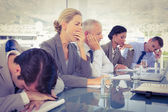 Tired business team at conference — Stock Photo
