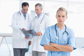 Irritated doctor looking at camera — Stock Photo