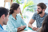 Creative business people in discussion — Stock Photo