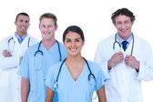 Artsen en verpleegkundigen permanent samen — Stockfoto