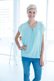 Smiling businesswoman at work — Stock Photo