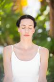 Portrait of a woman in a meditation position — Stock Photo