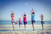 Friends doing yoga together with their teacher — Stock Photo