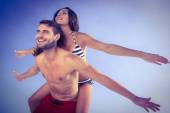 Man giving piggy back to girlfriend — Stock Photo