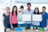 Creative business team holding signboard — Stock Photo