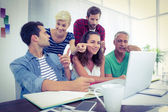 Creative business team using laptop in meeting — Stock Photo