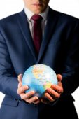 Hand of businessman holding terrestrial globe — Stock Photo