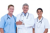 Doctors and nurse standing together — Stock Photo
