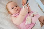 Baby girl with doctor with stethoscope — Stock Photo
