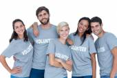 Volunteers friends smiling at the camera — Stock Photo