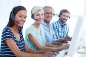 Casual call centre workers looking at the camera — Stock Photo