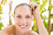 Blonde lying on towel at spa — Stock Photo
