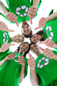 Friends wearing recycling tshirts forming huddle — Stock Photo