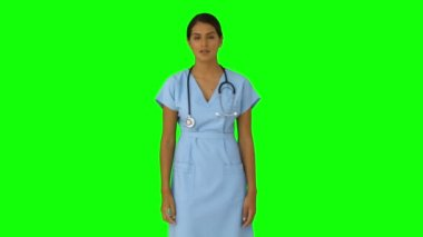 Nurse standing and pointing — Stock Video