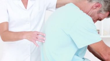 Doctor stretching her patient back — Stock Video