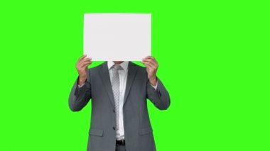 Businessman standing with page over face — Stock Video
