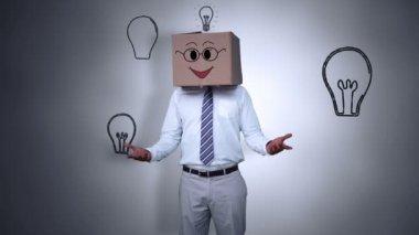 Businessman hiding head with happy box — Stock Video