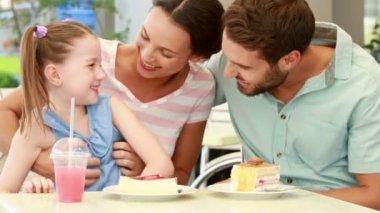 Family enjoying lunch in restaurant — Stock Video