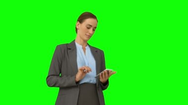 Serious businesswoman using her smartphone — Stock Video