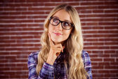 Blonde hipster daydreaming — Stock Photo