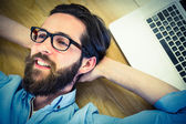 Handsome hipster using his laptop — Stock Photo