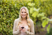 Young happy woman holding a glass of wine — Stock Photo