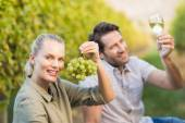 Two young happy vintners holding a glass of wine — Stock Photo