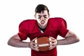 American football player crushing a ball — Stock Photo