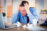 Stressed businessman with head in hands — Stock Photo