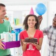 Casual business team celebrating a birthday — Stock Photo #81854034