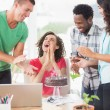 Casual business team celebrating a birthday — Stock Photo #81854610
