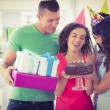 Casual business team celebrating a birthday — Stock Photo #81857886