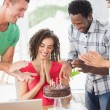 Casual business team celebrating a birthday — Stock Photo #81858476