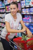 Woman buy products with his trolley — Stock Photo