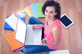 Young creative businesswoman holding a smartphone — Stock Photo