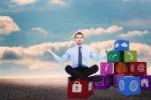 Calm businessman sitting in lotus pose — Stock Photo