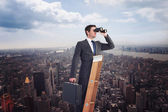 Businessman looking on a ladder — Stock Photo