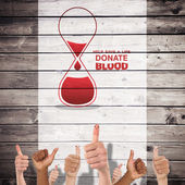 Blood donation against wooden planks — Stock Photo