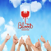 Blood donation against blue sky — Stock Photo