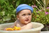 Child is bathed in a basin — Stock Photo