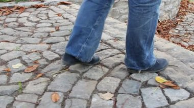 Walking on a paved alley — Stockvideo