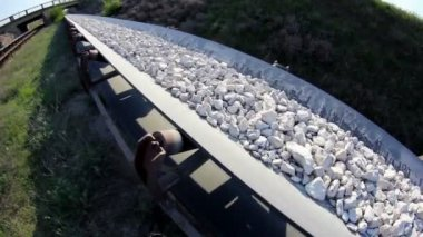 Fisheye of a conveyor belt transporting stones — Stock Video