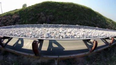 Fisheye of a conveyor belt transporting stones — Stock Video
